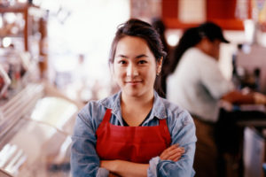 ASIAN CAFE OWNER/WORKER BEHIND COUNTER